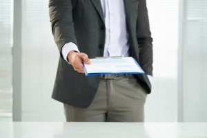http://www.dreamstime.com/stock-photography-business-strategy-cropped-image-businessman-holding-clipboard-company?s-foreground-image35960392