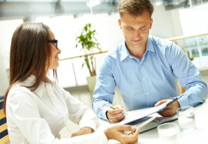 http://www.dreamstime.com/stock-photo-showing-results-young-businesswoman-looking-her-business-partner-explaining-document-image33381490