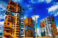 Brightly colored apartment buildings with blue sky