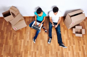 http://www.dreamstime.com/stock-photography-overhead-view-moving-couple-sitting-floor-together-using-computer-wireless-internet-new-home-image31576762