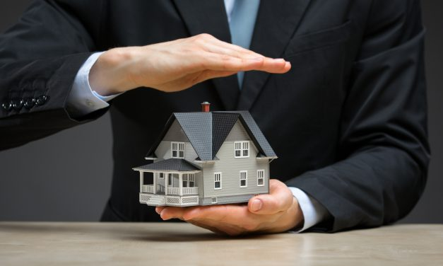 Can a mortgage holder foreclose on a property while processing a request for loan modification?