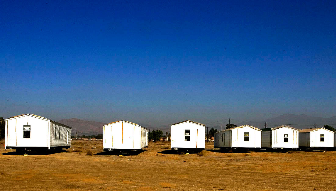 When setting the allowable increase in rent under a rent control ordinance, must a city consider a mobilehome park owner's debt obligations?