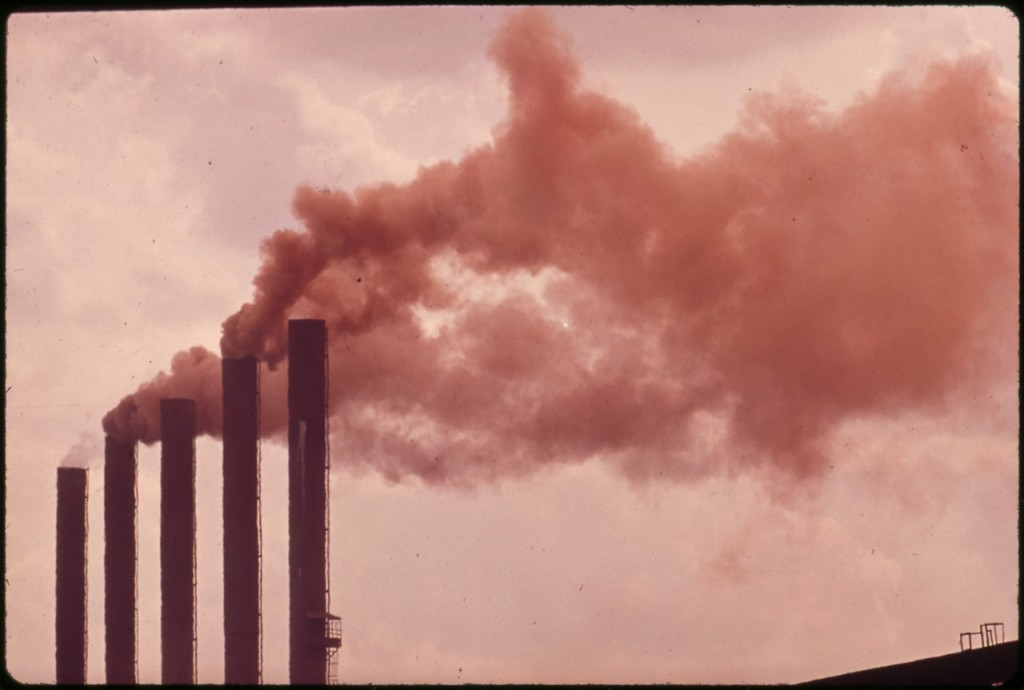 smoke out of factory chimneys